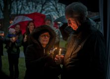 Vigil for Newtown shooting victims. Dozens of Vermonters gathered at City Hall Park in Burlington Vermont for a candle light vigil held in honor of the victims Royalty Free Stock Photos