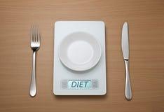 Vigilancia del peso de la escala de la dieta Imagen de archivo libre de regalías