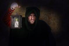 Vigilante de noche con una linterna Imagen de archivo