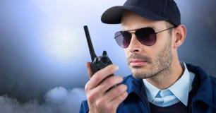 Vigilante de seguridad afuera con las nubes Imágenes de archivo libres de regalías