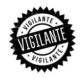 Vigilante rubber stamp. Grunge design with dust scratches. Effects can be easily removed for a clean, crisp look. Color is easily changed Stock Photos