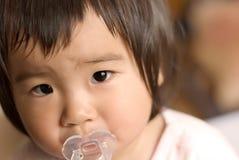 Vigilanza del bambino dell'Asia Immagini Stock