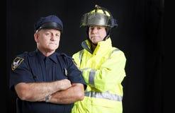 Vigile del fuoco e poliziotto con Copyspace Fotografie Stock