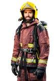 Vigile del fuoco in ingranaggio di estinzione di incendio Fotografia Stock Libera da Diritti
