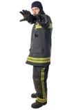 Vigile del fuoco in mano di manifestazioni dei vestiti da lavoro fotografie stock