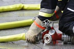 Vigile del fuoco sul lavoro fotografia stock