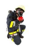Vigile del fuoco in uniforme isolata Fotografia Stock