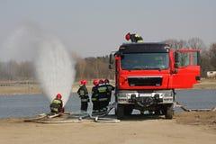 Vigili del fuoco durante l'esercizio Fotografia Stock