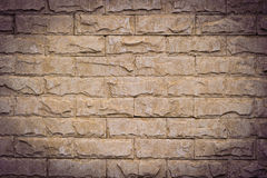 Vignette Background of Stone brick wall texture. Royalty Free Stock Image