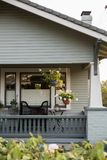 Craftsman home vignette with hanging plants. stock images
