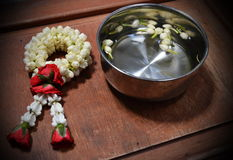 Vignette garland and jasmine in silver bowl Stock Photos