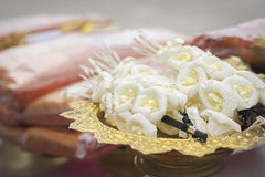Vignette Image of Artificial flowers (used during a funeral). Kind of wood flower to be placed on the site of cremation. (Selective Focus Stock Image