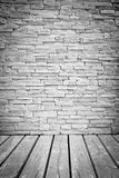 Vignette Light loft wall of stone blocks With wood flooring Royalty Free Stock Photo