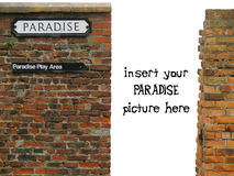 Vignette with paradise sign on old worn brick wall. A vignette with white background and a PARADISE sign on an old worn-out red brick wall. Replace the white Stock Images