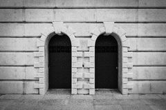 Vignette Pebble  Stones Wall with Metal Doors. Stock Photos