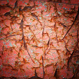 Vignette style red color cracked paint texture Stock Images