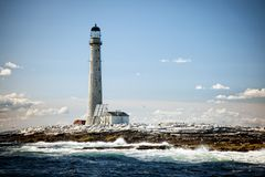 Vignette of Tallest Lighthouse in New England at Low Tide on Sum. Vignetted Image of Boon Island lighthouse at low tide in Maine on a summer day. It is the stock images