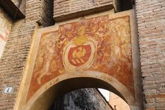 Antique painting on old arch in Vignola castle, Italy. Vignola, Italy - October 30, 2016: Antique painting on old arch in Vignola castle. Emilia-Romagna, Modena Stock Photography