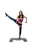 Vigorous athletic girl exercising on stepper Royalty Free Stock Photo