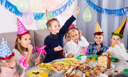 Vigorous children having a good time at a birthday party Royalty Free Stock Photos
