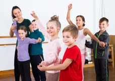 Vigorous little boys and girls dancing pair dance Stock Photography