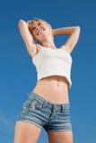 Vigorous smiling girl outdoors. Vigorous blond woman in shorts and white shirt outdoors Stock Photos