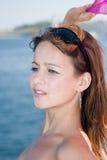 Vigorous young woman at the sea Royalty Free Stock Images