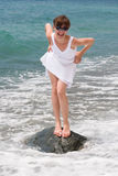 Vigorous young woman at the sea Royalty Free Stock Images