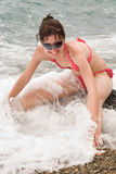 Vigorous young woman at the sea Royalty Free Stock Image