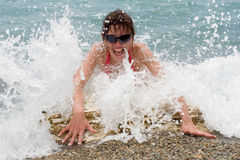 Vigorous young woman at the sea Royalty Free Stock Photography