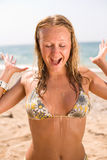 Vigorous young woman on seashore Stock Photos
