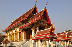 Thai temple soaring into blue sky Stock Images