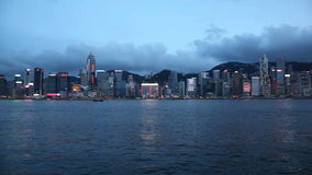 VIictoria Harbour in Central Hong Kong viewed from Tsim Sha Tsui in Kowloon, Hong Kong at Blue Hour 1080p. VIictoria Harbour in Central Hong Kong viewed from stock video footage