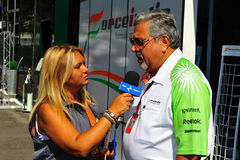 Vijay mallya. Of the Force India F1 team is talking to te press in the paddock on the circuit of monza, Italy Royalty Free Stock Image