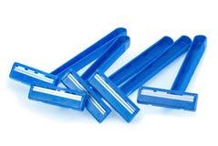 Vijf blauwe scheerapparaten Stock Foto's