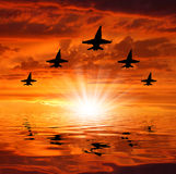 Vijf bommenwerpers over zonsondergang royalty-vrije stock afbeelding