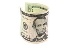 Vijf die dollars in een broodje worden gerold Royalty-vrije Stock Foto