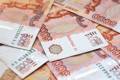 Vijf duizend Russische roebelsachtergrond stock foto's