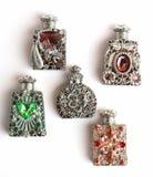 Vijf parfumflessen Stock Afbeelding