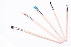 Vijf penselen op een witte achtergrond Stock Afbeeldingen