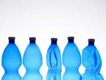 Vijf plastic flessen Royalty-vrije Stock Foto
