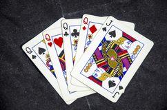 Vijf speelkaart ` s een hand van vier van een vriendelijke hefboom ` s en een koningin royalty-vrije stock fotografie