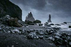 Vik and Basalt Columns, Black Sand Beach in Iceland.  royalty free stock images