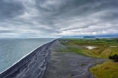 Vik beach under a cloudy sky in Iceland Stock Photos