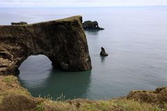 Iceland. Vik / Iceland - August 15, 2017: A arc stone view from Dyrholaey promontory, Vik, Iceland, Europe stock images