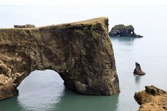 Iceland. Vik / Iceland - August 15, 2017: A arc stone view from Dyrholaey promontory, Vik, Iceland, Europe royalty free stock images
