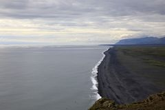 Iceland. Vik / Iceland - August 15, 2017: The volcanic beach view from Dyrholaey promontory, Vik, Iceland, Europe royalty free stock photo