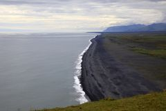 Iceland. Vik / Iceland - August 15, 2017: The volcanic beach view from Dyrholaey promontory, Vik, Iceland, Europe royalty free stock photos