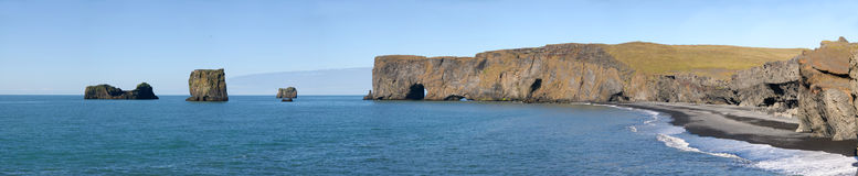 Vik nearby cliff panoramic. Overview jagged cliffs on the coast of Iceland Stock Image