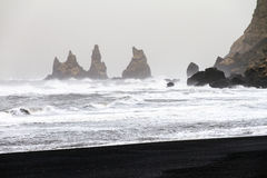 Vik ominous rocks. Beautiful winter view of the rocks and rough sea at the black beach of Vik in Iceland royalty free stock image